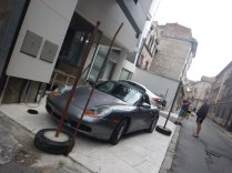 Fancy cars next to much poorer workers, Belgrade, 16 Aug