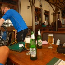 Bike maintenance over lunch in only restaurant open in Lom, 21 Aug
