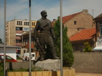 Communist statue in old square, Lom, 21 Aug