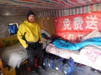 Laurence in typical Taklamakan hostel room