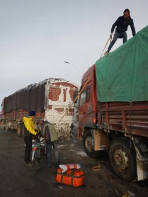 Lobby's bike being loaded in Maduo, en route to Xiewu, 31 Jan 15