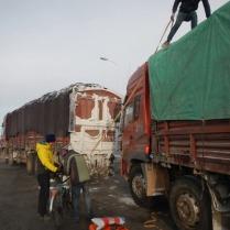 Lobby's bike being loaded in Maduo, en route to Xiewu, 31 Jan 15