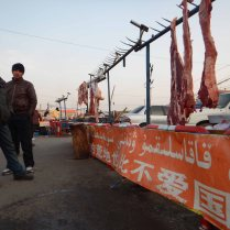 Slogans in both Arabic and Chinese script, here in the Uighur part of Kuqa, 10 Jan 15
