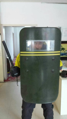 Only in China will they hand a foreigner a riot shield and taser to try out