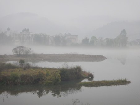 Mist over a river in southern China